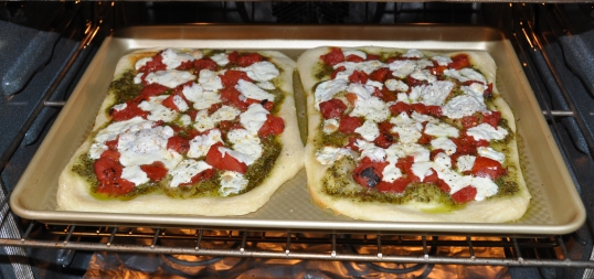 Homemade Pizza with Pesto, Fire-Roasted Tomatoes, and Mozzarella