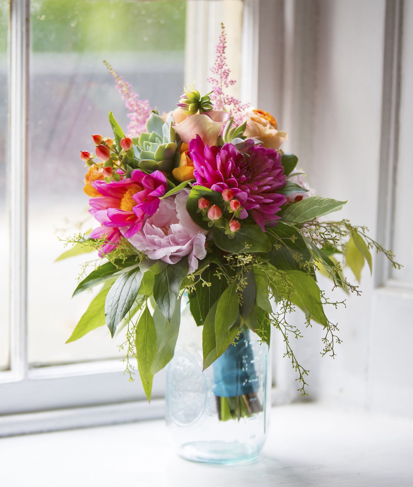 wedding flowers wedding flower arrangements Wedding Bouquet bright pink dahlias pale garden roses and peach roses with a blue