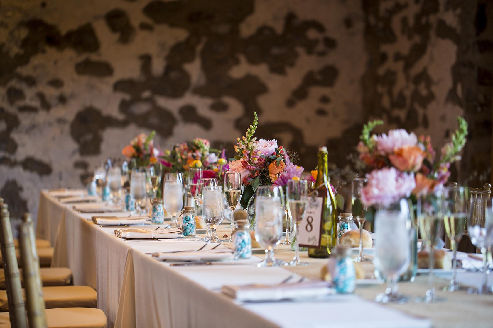 Wedding Flower Arrangements In Mason Jars On Long Tables