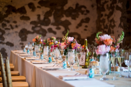 Wedding Flower Arrangements in Mason Jars on Long Tables