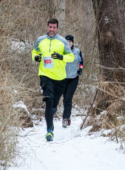 The guy in yellow took the lead through the entire trail section and I stayed tucked in right behind him (as this photo illustrates... you can hardly see me!) Photo Credit: RunningMadPhoto