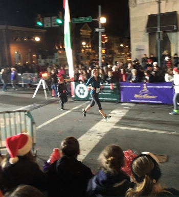 Crossing the finish line -- look at the huge parade crowd!
