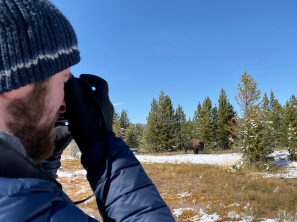 Matt taking a photo of a Bison